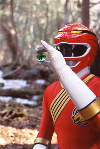 Red Ranger holding crystal of the Gorilla
