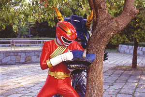 Red Ranger fights free of Vacuum Cleaner Org's attack