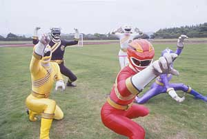 Red Ranger leads off the team on a soccer field