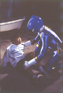 Blue Ranger helping a little boy